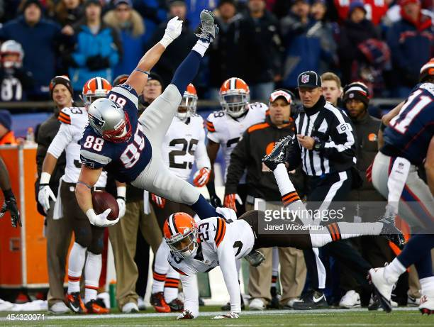 Matthew Mulligan of the New England Patriots leaps over Joe Haden of the Cleveland Browns after catching a pass in the fourth quarter during the game...