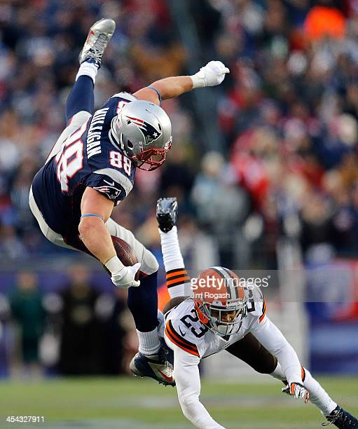Matthew Mulligan of the New England Patriots leaps over Joe Haden of the Cleveland Browns to gain yards in the 4th quarter at Gillette Stadium on...