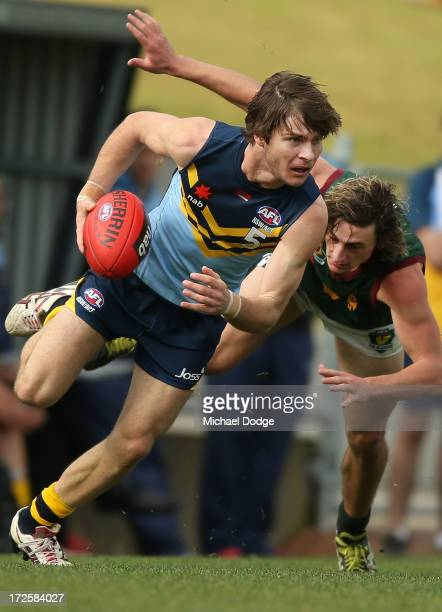 Matthew Munro of NSW/ACT runs with the ball during the round five AFL Under 18s Championship match between NSW/ACT and Tasmania at Victoria Park on...