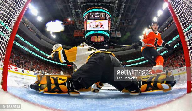 Matthew Murray of the Pittsburgh Penguins makes a glove save on a scoring chance by Nolan Patrick of the Philadelphia Flyers in Game Three of the...