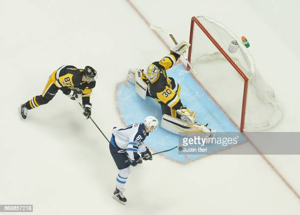 Matthew Murray of the Pittsburgh Penguins makes a save on a shot by Kyle Connor of the Winnipeg Jets in the third period during the game at PPG...