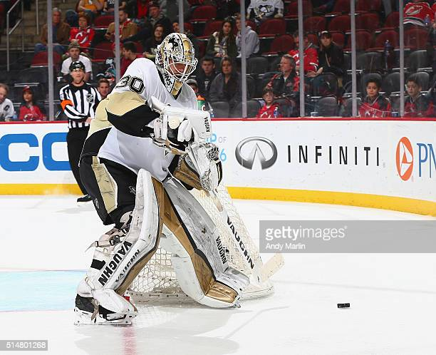 Matthew Murray of the Pittsburgh Penguins plays the puck against the New Jersey Devils during the game at the Prudential Center on March 6 2016 in...