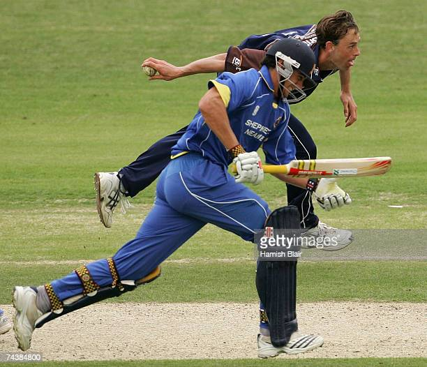 Matthew Nicholson of Surrey swoops in to run out Alastair Cook of Essex during the Friends Provident Trophy one day match between Surrey CCC and...