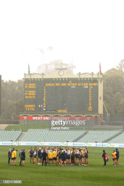 Matthew Nicks, head coach of the Crows addresses his players during an Adelaide Crows AFL training session at Adelaide Oval on August 05, 2021 in...