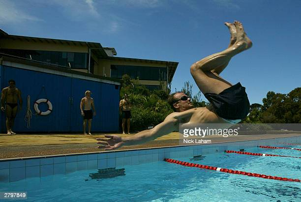 Matthew Nicks somersaults into the pool during the Sydney Swans AFL team's preseason training session at the Botany pools December 10 2003 in Sydney...