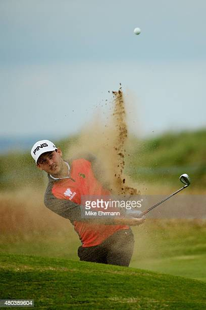 Matthew Nixon of England hits a shot from a bunker on the ninth hole during the third round of the Aberdeen Asset Management Scottish Open at Gullane...