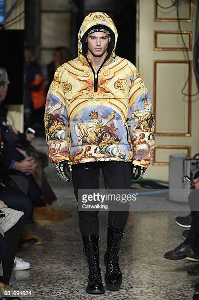 Matthew Noszka walks the runway at the Moschino Autumn Winter 2017 fashion show during Milan Menswear Fashion Week on January 14 2017 in Milan Italy