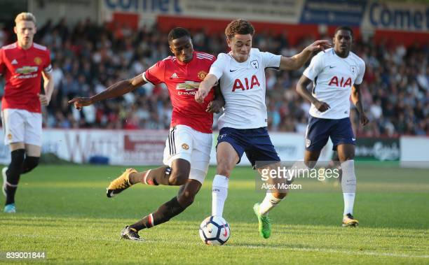 Matthew Olosunde of Manchester United and Luke Amos of Tottenham during the Premier League 2 match between Tottenham Hotspur and Manchester United at...