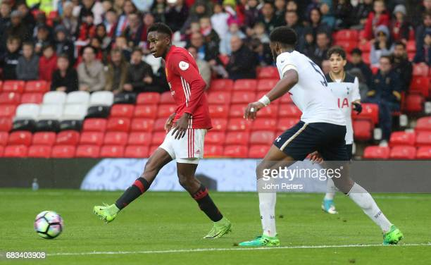 Matthew Olosunde of Manchester United U23s in action with Christian Maghoma of Tottenham Hotspur during the Premier League 2 match between Manchester...