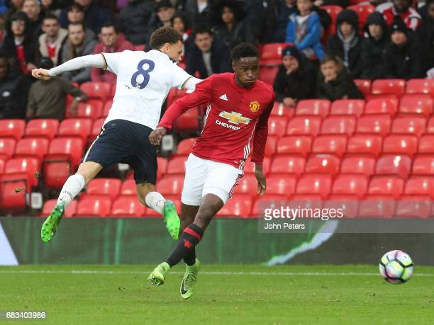 Matthew Olosunde of Manchester United U23s in action with Luke Amos of Tottenham Hotspur during the Premier League 2 match between Manchester United...