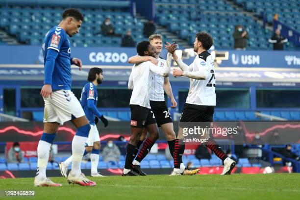 Matthew Olosunde of Rotherham United celebrates with teammates after scoring his team's first goal during the FA Cup Third Round match between...