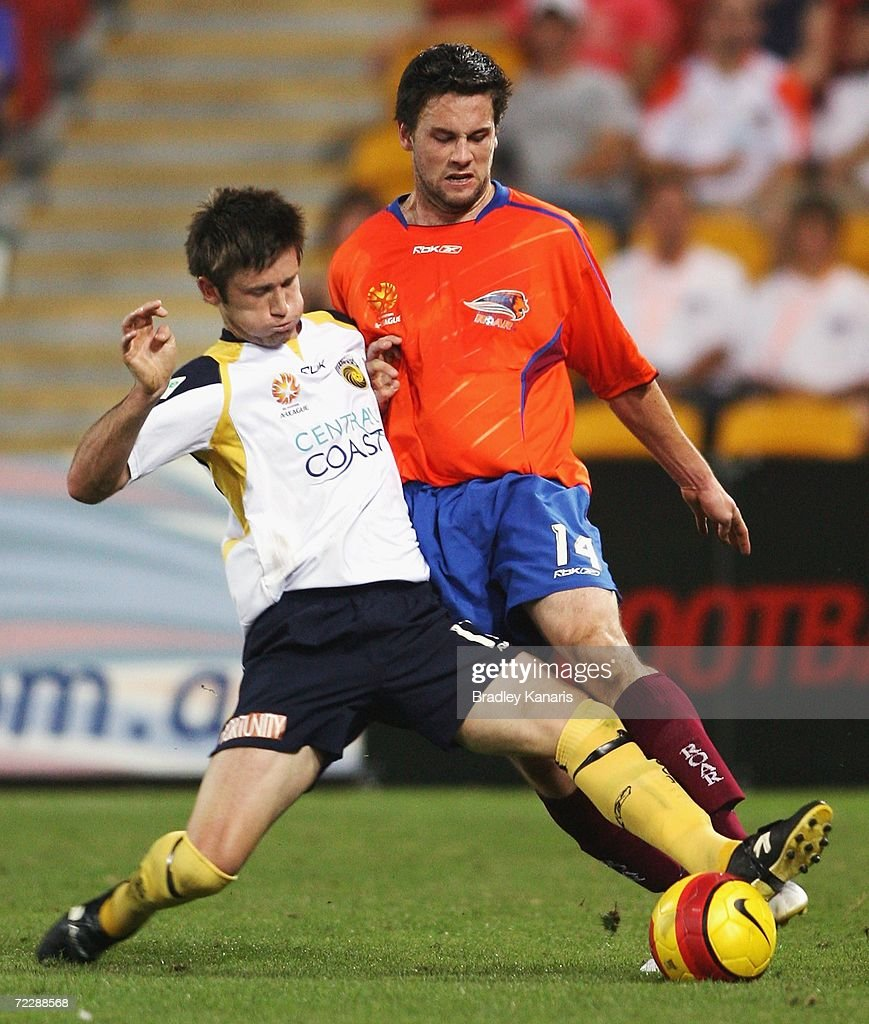 Matthew Osman of the Mariners challenges Ben Griffin of the Roar during the round ten Hyundai A-League match between the Queensland Roar and the Central Coast Mariners at Suncorp Stadium on October 28, 2006 in Brisbane, Australia.