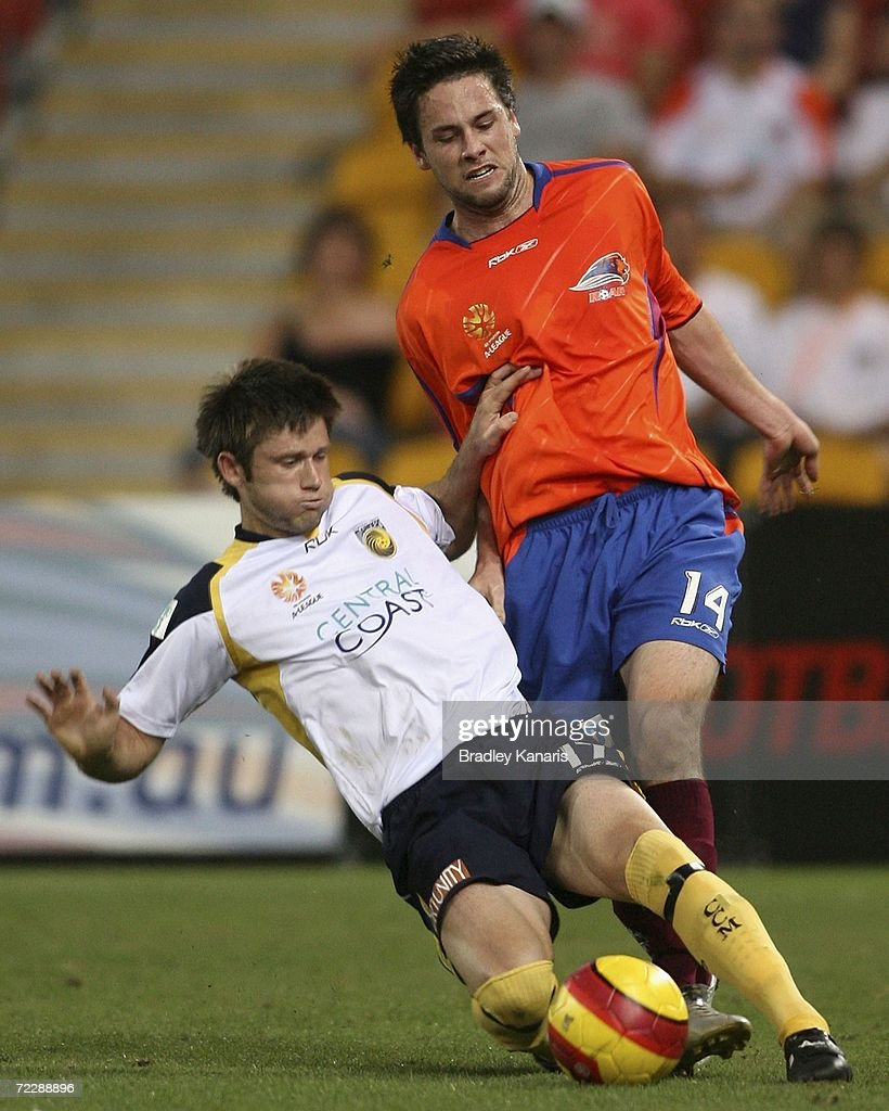 Matthew Osman of the Mariners tackles Ben Griffin of the Roar during the round ten Hyundai A-League match between the Queensland Roar and the Central Coast Mariners at Suncorp Stadium on October 28, 2006 in Brisbane, Australia.