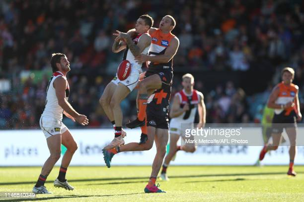 Matthew Parker of the Saints is challenged for a mark by Heath Shaw of the Giants during the round seven AFL match between the Greater Western Sydney...