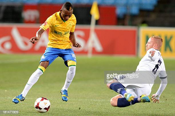 Matthew Pattison of Wits tackles Khama Billiat of Mamelodi Sundowns during the Absa Premiership match between Mamelodi Sundowns and Bidvest Wits from...