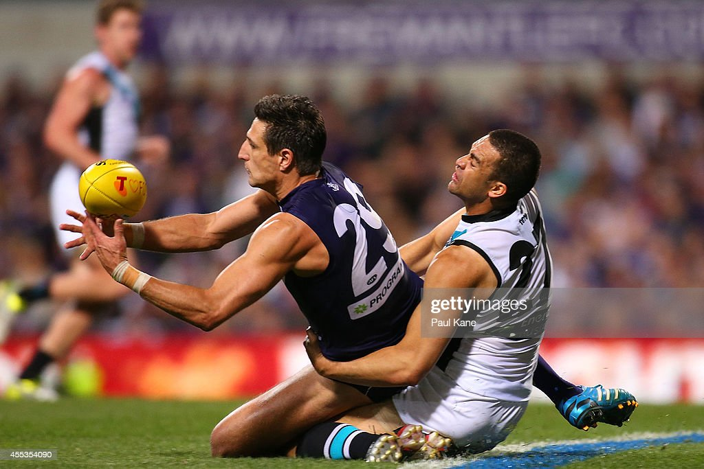 Matthew Pavlich of the Dockers attempts to mark the ball against Alipate Carlile of the Power during the AFL 1st Semi Final match between the Fremantle Dockers and the Port Adelaide Power at Patersons Stadium on September 13, 2014 in Perth, Australia.