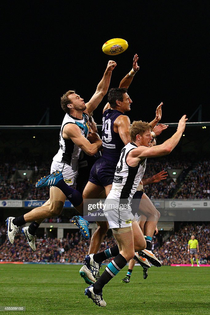 Matthew Pavlich of the Dockers contests a mark against Jack Hombsch and Matthew Lobbe of the Power during the AFL 1st Semi Final match between the Fremantle Dockers and the Port Adelaide Power at Patersons Stadium on September 13, 2014 in Perth, Australia.