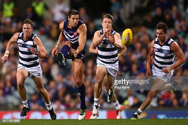 Matthew Pavlich of the Dockers kicks the ball into the forward line during the round 17 AFL match between the Fremantle Dockers and the Geelong Cats...