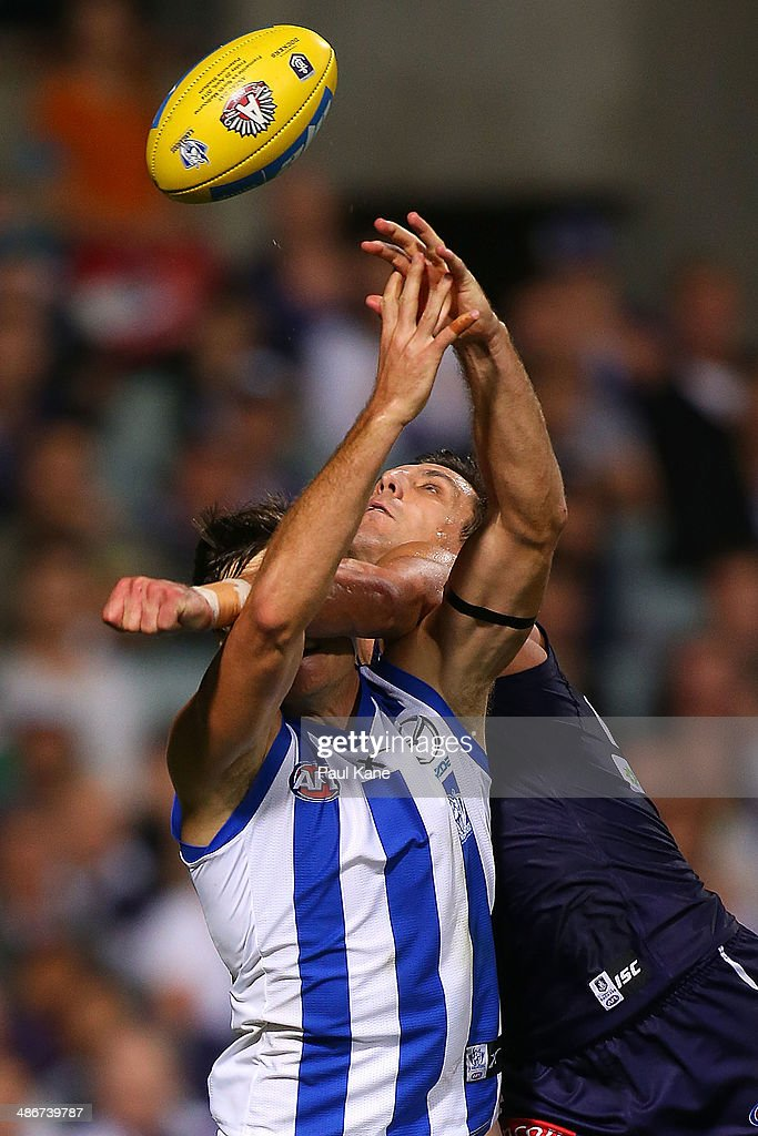 Matthew Pavlich of the Dockers spoils the mark for Joel Tippett of the Kangaroos during the round six AFL match between the Fremantle Dockers and the North Melbourne Kangaroos at Patersons Stadium on April 25, 2014 in Perth, Australia.