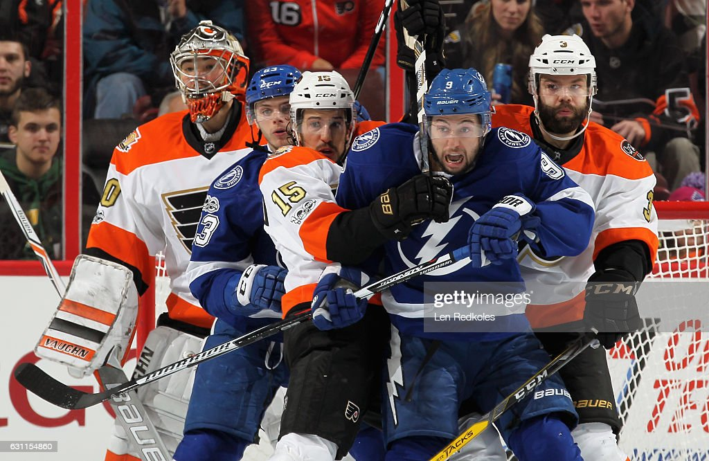 Matthew Peca #63 and Tyler Johnson #9 of the Tampa Bay Lightning battle for position in front of goaltender Michal Neuvirth #30 of the Philadelphia Flyers with Michael Del Zotto #15 and Radko Gudas #3 on January 7, 2017 at the Wells Fargo Center in Philadelphia, Pennsylvania.