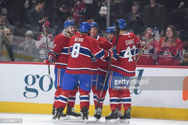 Matthew Peca of the Montreal Canadiens celebrates with teammates after scoring a goal against the Ottawa Senators in the NHL game at the Bell Centre...