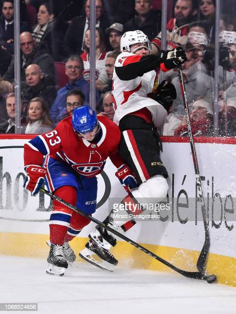 Matthew Peca of the Montreal Canadiens delivers a hit on Zack Smith of the Ottawa Senators during the NHL game at the Bell Centre on December 4 2018...