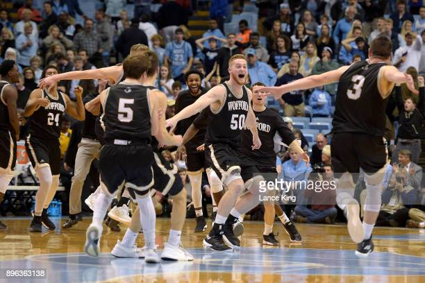 Matthew Pegram and Fletcher Magee of the Wofford Terriers celebrate with teammates following their win against the North Carolina Tar Heels at Dean...