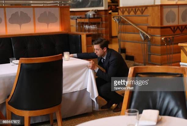 Matthew Pene Maitre d' at Eleven Madison Park checks the dining room before dinner on April 6 2017 in New York City The esteemed restaurant has...