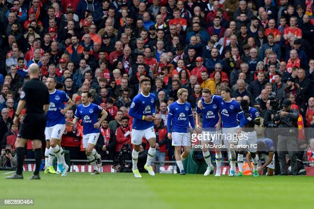 Matthew Pennington celebrates his goal with team mates during the Premier League match between Liverpool and Everton at Anfield on April 1 2017 in...