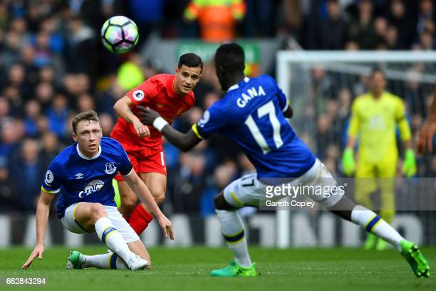 Matthew Pennington of Everton and Philippe Coutinho of Liverpool battle for possession during the Premier League match between Liverpool and Everton...