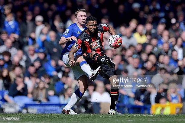 Matthew Pennington of Everton challenges Joshua King of Bournemouth during the Barclays Premier League match between Everton and AFC Bournemouth at...