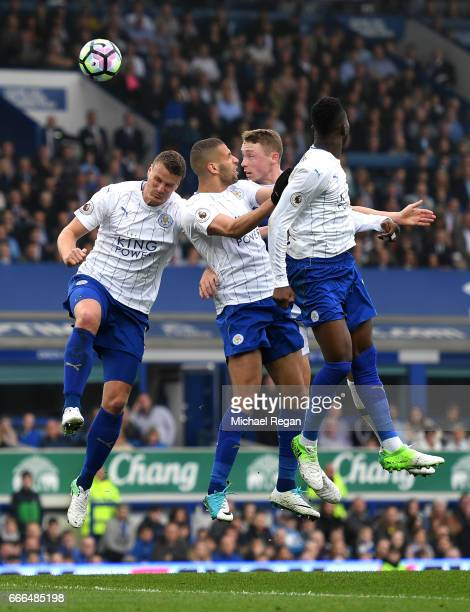 Matthew Pennington of Everton wins a header with Robert Huth Islam Slimani and Daniel Amartey of Leicester City during the Premier League match...