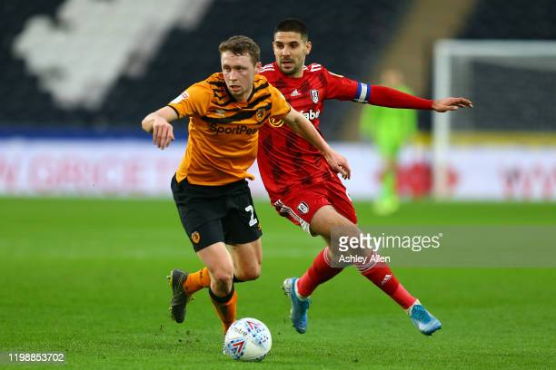 Matthew Pennington of Hull City keeps the ball from Aleksandar Mitrović of Fulham during the Sky Bet Championship match between Hull City and Fulham...