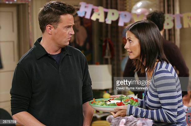 "Matthew Perry and Courteney Cox Arquette perform on the hit NBC series ""Friends"" during one of their last shows on the Warner Bros lot Sept. 12, 2003..."