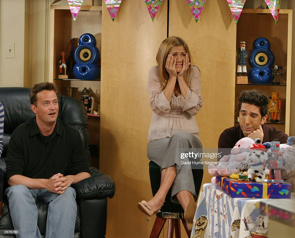 Matthew Perry (L), Jennifer Aniston, and David Schwimmer, cast members of the hit NBC series 'Friends,' react during a scene on one of their last shows on the Warner Bros lot Sept. 12, 2003 in Burbank, CA. 'Friends,' which is in its ninth and final season, debuted in 1994, has won 44 Emmys, and is one of the biggest successes in television history. (Photo by David Hume Kennerly/Getty Images) This image is not included in any subscription deal. Use of this image will incur a charge.