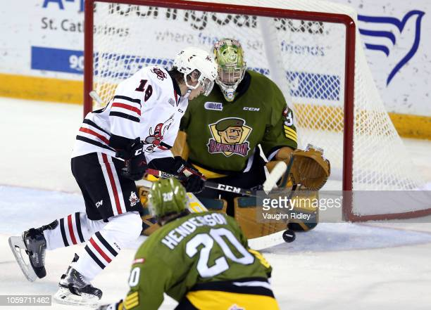 Matthew Philip of the Niagara IceDogs scores a goal during the second period of an OHL game against the North Bay Battalion at Meridian Centre on...