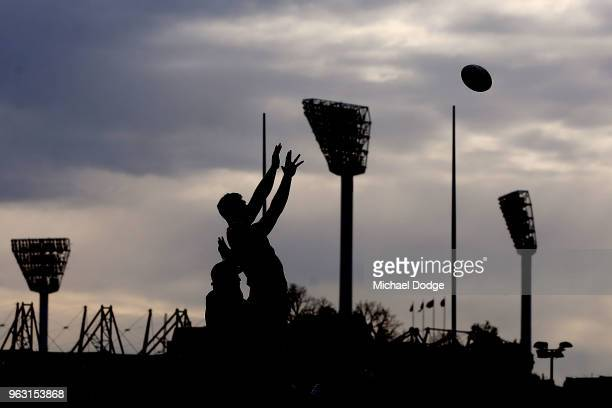 Matthew Philip of the Rebels receives the ball in front of the Melbourne Cricket Ground light towers during a Melbourne Rebels Super Rugby training...