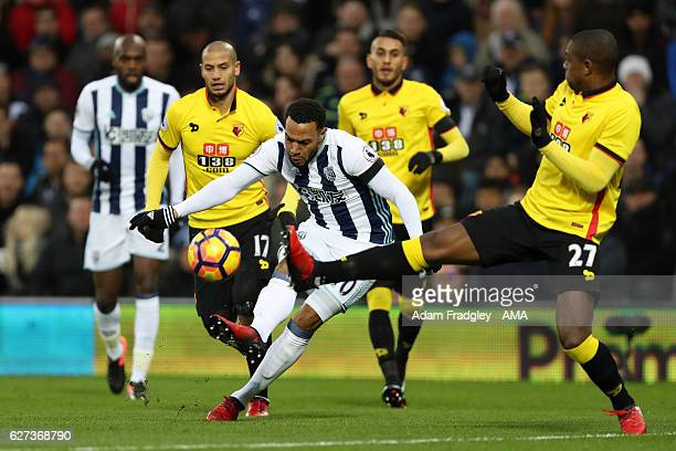 Matthew Phillips of West Bromwich Albion is challenged by Christian Kabasele of Watford during the Premier League match between West Bromwich Albion...