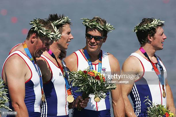 Matthew Pinsent Ed Coode James Cracknell and Steve Williams stand on the podium after winning the Gold medal in the men's four rowing final on August...