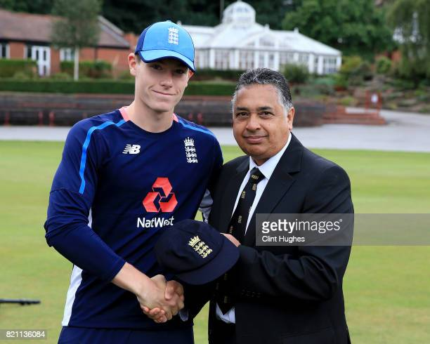 Matthew Potts of England is presented with his first cap by England U19 selector John Abrahams during the England U19 v India U19 match at Queen's...