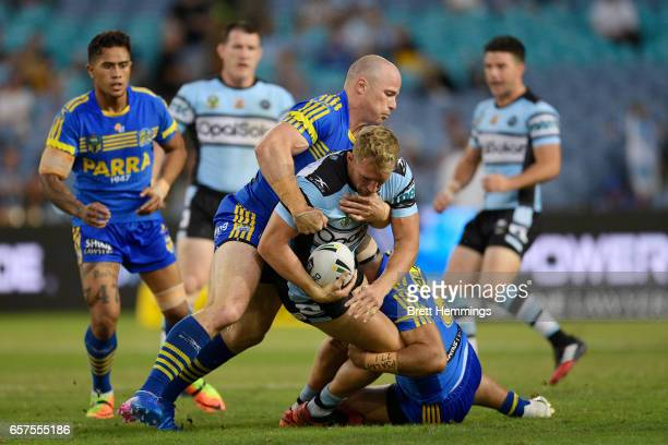 Matthew Prior of the Sharks is tackled during the round four NRL match between the Parramatta Eels and the Cronulla Sharks at ANZ Stadium on March 25...