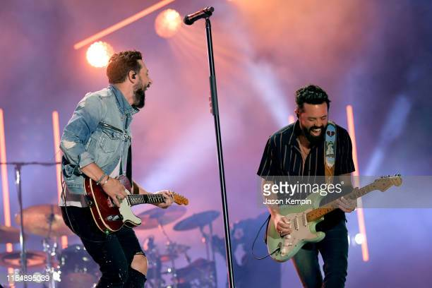 Matthew Ramsey and Brad Tursi of Old Dominion perform on stage for day 4 of the 2019 CMA Music Festival on June 09 2019 in Nashville Tennessee