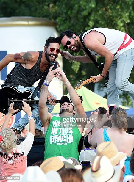 Matthew Ramsey and Brad Tursi of Old Dominion stop for a selfie during their performance at Kicker Country Stampede Manhattan Kansas Day 1 on June 25...