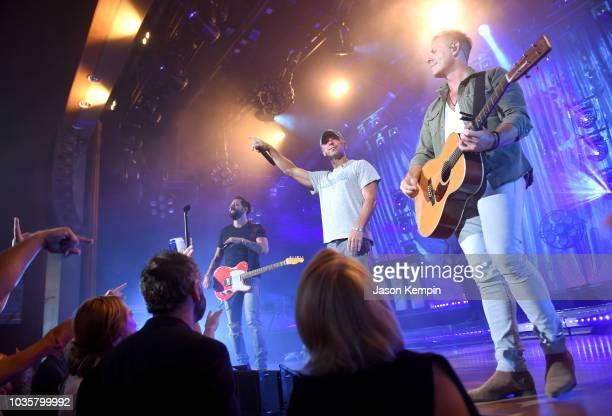 Matthew Ramsey of Old Dominion Kenny Chesney and Trevor Rosen of Old Dominion perform at the Ryman Auditorium on September 18 2018 in Nashville...