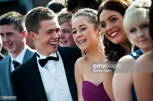 Matthew Rayner and Erin Bowmaker pose for pictures with school friends before catching the bus to the school prom on July 1 2011 in Newcastle United...