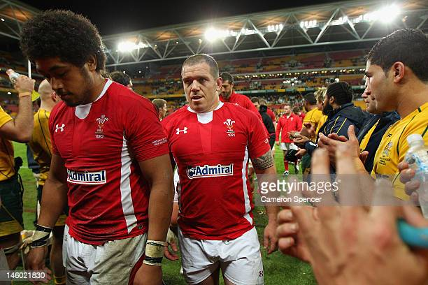Matthew Rees of Wales and team mates leaves the field after losing the international test match between the Australian Wallabies and Wales at Suncorp...