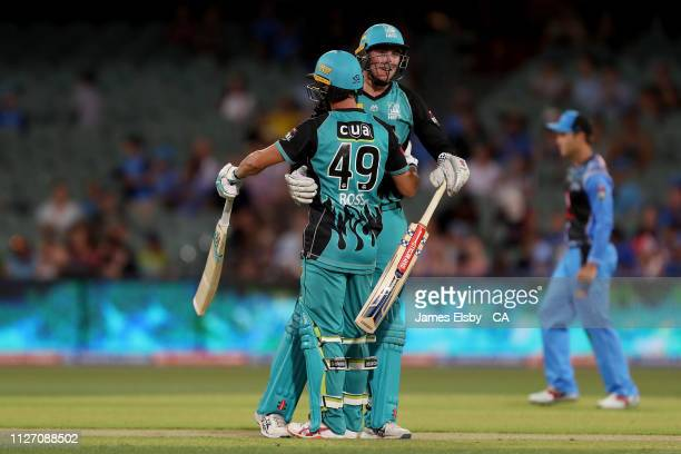 Matthew Renshaw and Alex Ross of the Heat celebrate their win during the Big Bash League match between the Adelaide Strikers and the Brisbane Heat at...