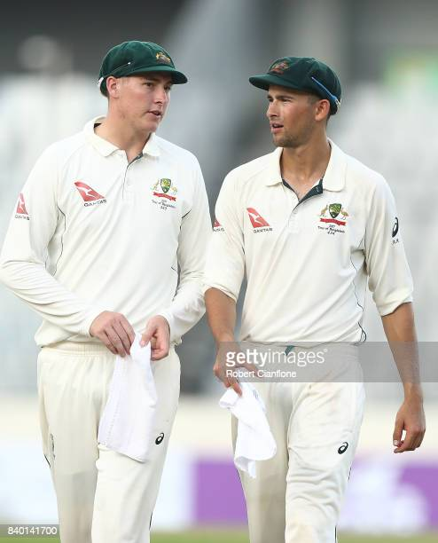 Matthew Renshaw and Ashton Agar of Australia walk off the ground at the end of day two of the First Test match between Bangladesh and Australia at...