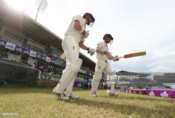 Matthew Renshaw and David Warner of Australia head out to bat during day three of the First Test match between Bangladesh and Australia at Shere...