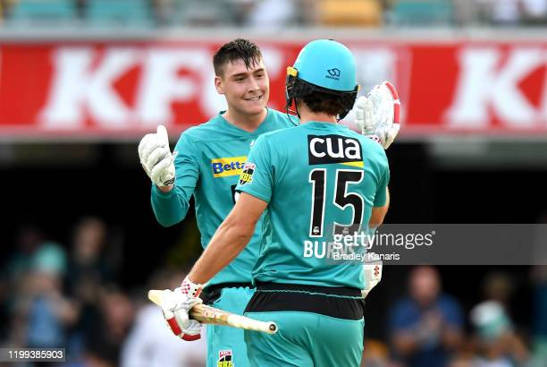 Matthew Renshaw and Joe Burns of the Heat celebrate victory after winning the Big Bash League match between the Brisbane Heat and the Adelaide...